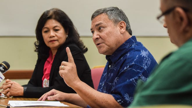 Gov. Eddie Calvo, center, talks about his bills to borrow $125 million and raise the Business Privilege Tax so Guam Memorial Hospital Authority could make capital improvements at Adelup on July 7.