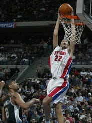 Pistons forward Tayshaun Prince catches an alley-oop