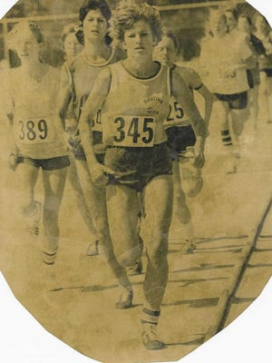 Betsy Oberle (345) takes the lead at the Illinois High School Association girls state track and field finals in the mile in 1975 for Academy of Our Lady/Spalding Institute. Oberle won the mile in 1975 and 1976.
