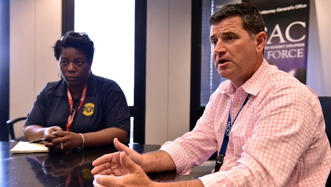 Jay Houston, commander of the Internet Crimes Against Children Task Force, and Angela Williams, assistant commander, talk from their Jackson office about the challenges they face tracking down child predators.