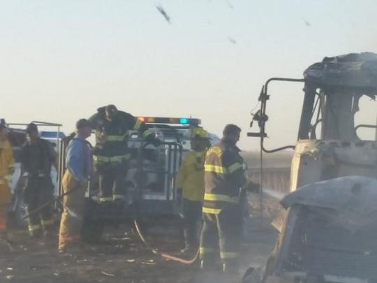 Fire fighters douse flames at a semi on the northeast corner of 470th Avenue and 90th Street northwest of Montezuma which had been caught in a grass/field fire that destroyed approximately 500 acres south of Ewart. The cause of the fire is under investigation.