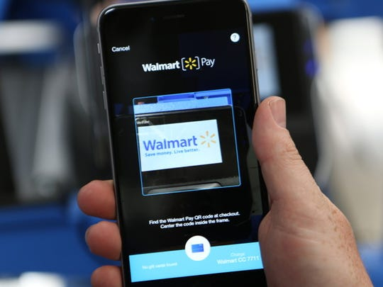 A customer uses the Walmart Pay, the company's mobile