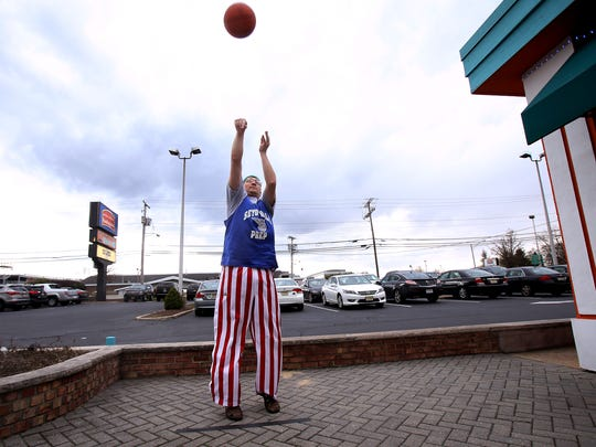 Dan Butler of Sea Bright shoots free throws during a break in the NCAA basketball tournament on the patio outside Miami Mikes. Butler was one of many friends attending an annual watch party for the NCAA men's basketball tournament.