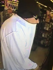 Security camera image of a man robbing a Family Dollar