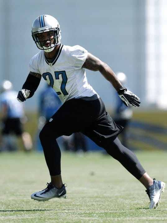 FILE- In a June 4, 2013 file photo, Detroit Lions safety Glover Quin runs during NFL football practice in Allen Park, Mich. Safety seems to be a position of strength for the Lions with Quin and newcomer James Ihedigbo. (AP Photo/Paul Sancya, Files)
