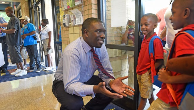 Director of Schools Dr. Shawn Joseph talks with Tyler and Landon Adams as they arrive for the first day of school. The twins will be in second grade this year at Tom Joy Elementary.