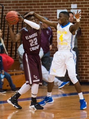 BTW Magnet's Thomas Green (4) defends against Elmore County's Johnnie Jasper (22) in area tournament action at Lanier High School in Montgomery, Ala. on Saturday February 12, 2016.
