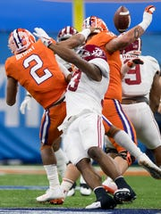 Alabama linebacker Anfernee Jennings (33) hits Clemson quarterback Kelly Bryant (2)  causing him to throw an interception in the Sugar Bowl at the Superdome in New Orleans, La. on Monday January 1, 2018.