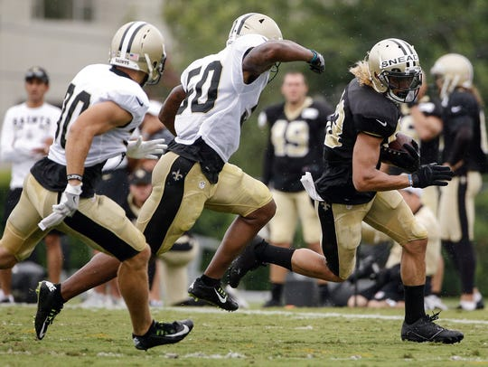 New Orleans Saints wide receiver Willie Snead is pursued