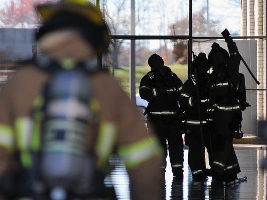 Firefighters investigate a suspicious odor at the Richland Mall on Sunday afternoon.