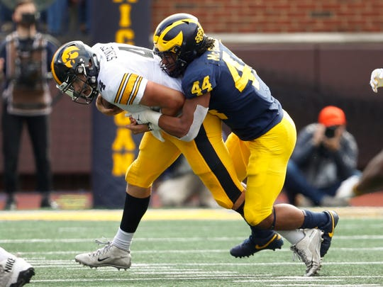Michigan linebacker Cameron McGrone (44) sacks Iowa quarterback Nate Stanley (4) during the second half of an NCAA college football game in Ann Arbor, Mich., Saturday, Oct. 5, 2019. (AP Photo/Paul Sancya)