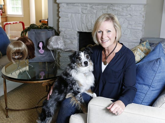 Breast cancer survivor Kate Conn is the co-founder of the Wig Exchange, an organization that has loaned out more than 300 wigs to local breast cancer patients since 2012. Kate with her dog, Phinn, at home in Rye.