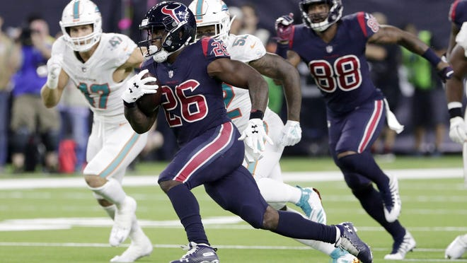 Texans running back and ex-Dolphin Lamar Miller (26) breaks for a long run during the second half of Thursday's game.