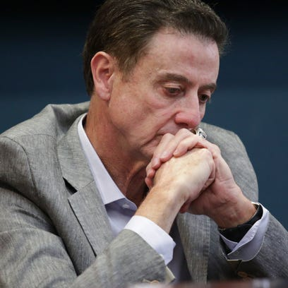 U of L basketball coach, Rick Pitino, looks on during