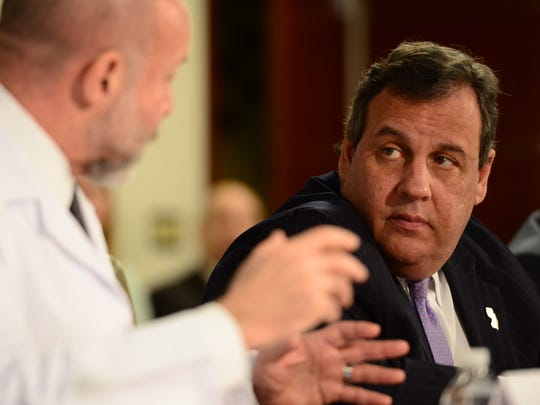 Gov. Christie listens to Dr. Mark Rosenberg, chairman of emergency health at St. Joseph in Paterson, talk about the opioid situation he sees at the hospital.