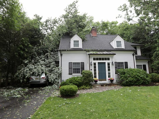 A large tree fell on 11 Lloyd Rd. in Ho-Ho-Kus Monday afternoon, June 19, 2017, however, no injuries were reported.  The foundation of the home may be compromised as a result of the fall.