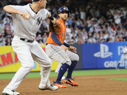 George Springer stops as he can see Todd Frazier with the ball.  Frazier threw to first to end the top of the second inning of Game 5, Wednesday, October 18, 2017.