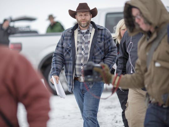 Ammon Bundy leaves after making a statement at a news