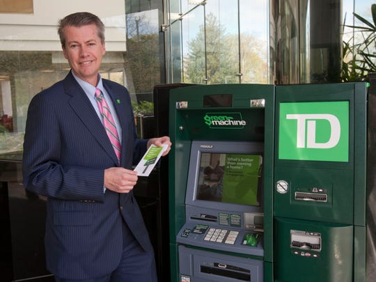 Jim Kiernan, Shore market president at TD Bank in Tinton Falls, with the ATM machine in the bank lobby.
