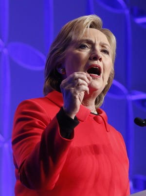 Democratic presidential candidate, Hillary Clinton, speaks at Minnesota's Democratic-Farmer-Labor party's Humphrey-Mondale dinner, Friday in St. Paul.