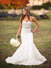 The bride's trumpet-style lace wedding gown was by
