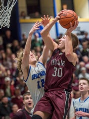 McConnellsburg's Ian Cheatle tries to block Dylan Gordan's shot during the District 5 boys basketball championship in Johnstown, Pa. on Friday, Feb. 26, 2016. Gordon scored 29 points overall.