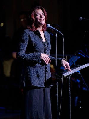 Rosanne Cash was the consummate host, telling the stories behind the tunes Friday at Washington Park