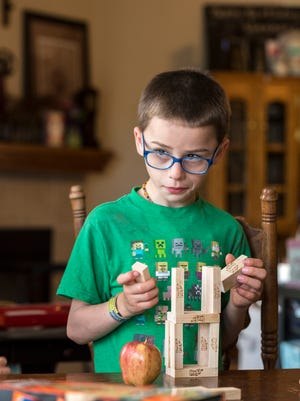Olly Ajluni, 7, at home on Monday, June 5, 2017. He has battled Langerhan Cell Histiocytosis, a rare cancer/autoimmune hybrid disease, since 2012.
