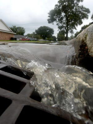 Water pouring into a storm drain