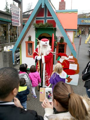 Nordic Father Christmas, portrayed by Danny Fritts, poses for photos in downtown Poulsbo, Washington on Saturday, November 25, 2017. The Nordic Father Christmas House will be open to visitors every weekend until Dec. 23.