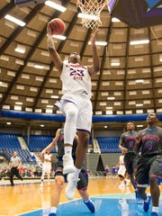 Northwestern State's Darian Dixon (23) skies for a layup during Saturday's game at the Rapides Coliseum against Louisiana College.