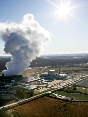 Steam rises from cooling towers at the Duane Arnold Energy Center beside the Cedar River in this aerial image taken over Palo on Friday, Nov. 21, 2008.