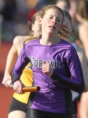 Norwalk's Emily Bellizzi runs the first leg of the 4x800-meter relay. The Simpson College High School Classic was held March 26 in Indianola.