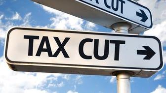 A sign labeled tax cut followed by an arrow