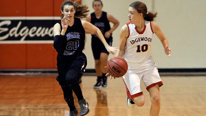 Lily Monaghan of Space Coast pursues Lhotse Thompson of Edgewood during their game Wednesday.