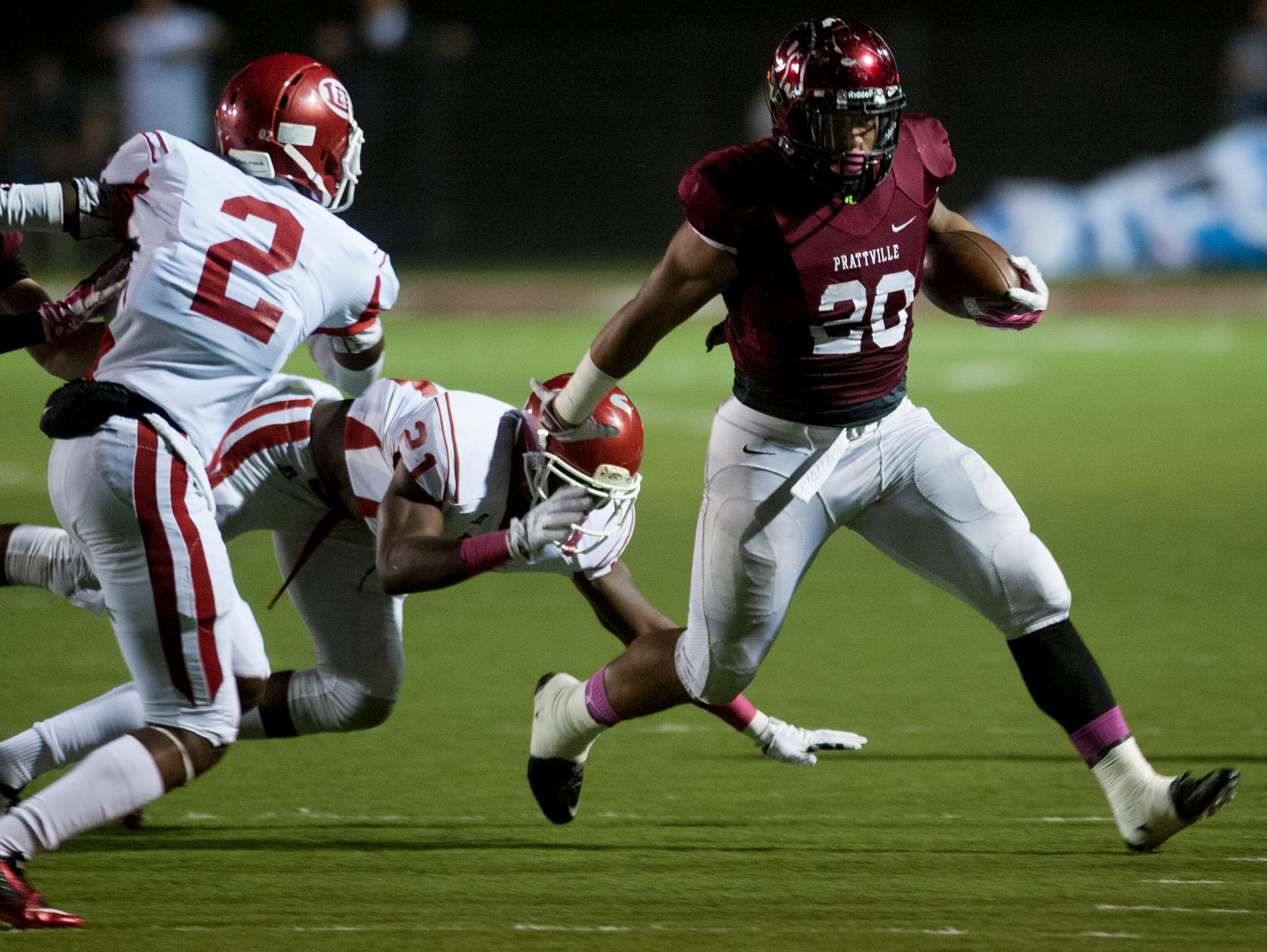 Prattville's Kingston Davis carries against Lee at Stanley Jensen Stadium in Prattville, Ala. on Friday October 23, 2015.