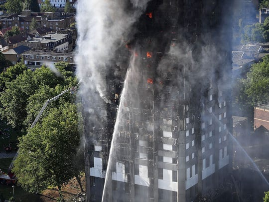 Fire fighters tackle a huge fire that engulfed the 24-story Grenfell Tower in Latimer Road, West London in the early hours of this morning on June 14, 2017 in London, England.