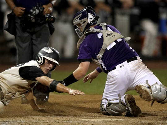 Waupun High School's Collin Witthun is tagged out at