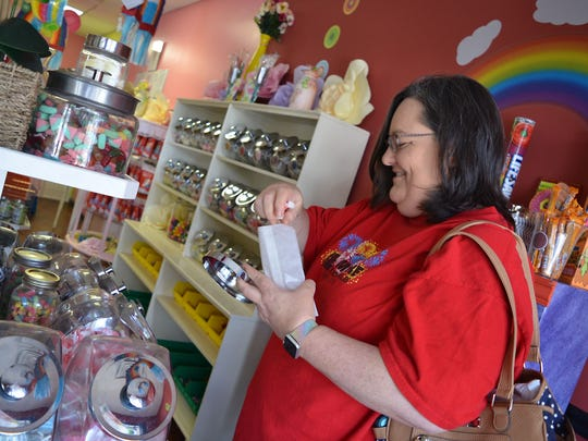 Tina Bethany, of Florence, fills a bag of assorted taffy while spending time at Cotton Candy Heaven located at 1189 Old Fannin Rd., Suite D, in Brandon.