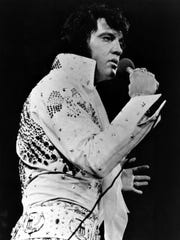 Elvis Presley performs in this 1971 file photo at an unknown location.