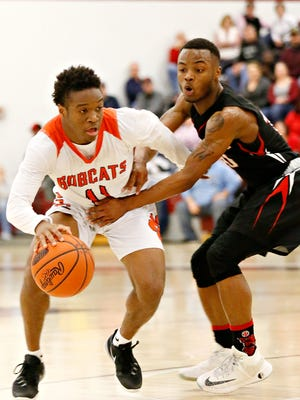 Fred Mulbah, left, helped Northeastern to the best season in program history this winter. The Bobcats captured their first Division I, York-Adams League and District 3 crowns. They also made the state semifinals and earned 30 wins. Dawn J. Sagert photo