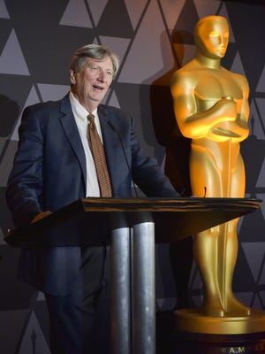 Academy president John Bailey speaks onstage at a reception on March 2.