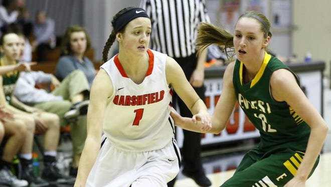 McKayla Scheuer, left, and the Marshfield girls basketball team earned a No. 1 seed in Division 1 for the WIAA playoffs