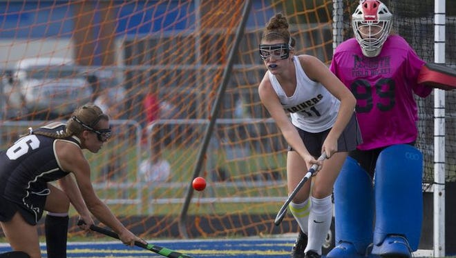 Toms River North's Tara Flavin moves in to block a shot by Southern's Andrea Janowiak as goalie Gabby Gibson comes in to assist on the play during the Class A South game on Sep. 27, 2016