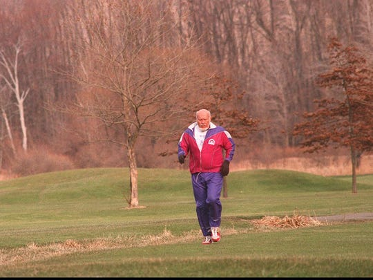 Don McNelly, then 74, runs at Durand-Eastman Golf Course, near his home, in January 1995 as he prepared to run in Antarctica the following month.
