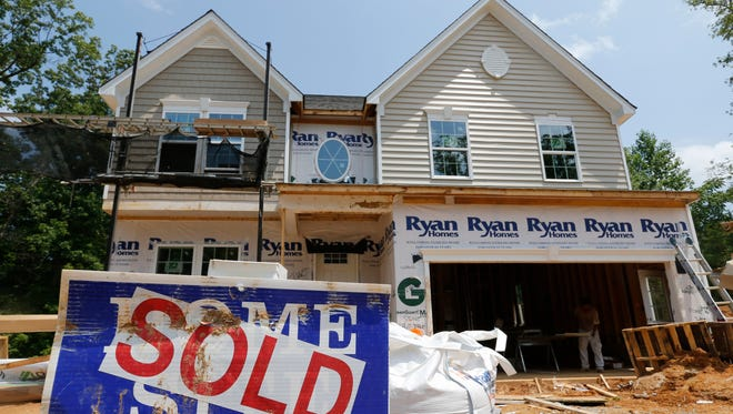 FILE - In this file photo photo taken, June 8, 2015, a sold sign is displayed outside a new home under construction in Mechanicsville, Va.  Average long-term U.S. mortgage rates dropped this week of Aug. 24, 2015, to their lowest levels since May, in a week marked by turmoil in global markets that was stoked by economic developments in China.