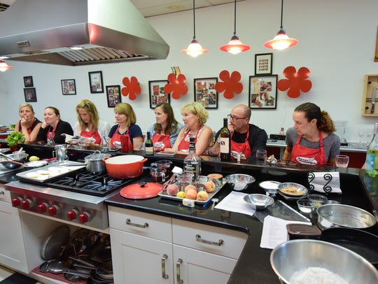 Students attend a cooking class at Taste & Technique