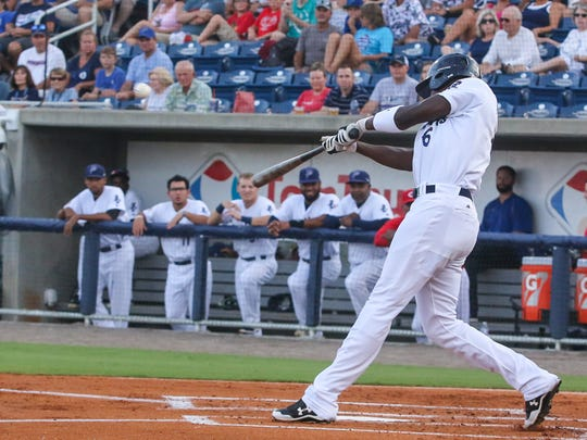 Pensacola's Aristides Aquino (6) hits the ball into right field against Chattanooga at Admiral Fetterman Field on Monday, July 10, 2017.