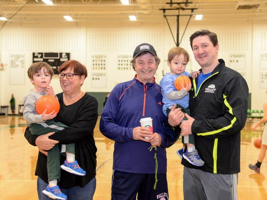 Pascack Valley High School girls basketball team practice in February 2017 led by coach Jeff Jasper, center. On this day, like most others, Jeff Jasper's wife Lois, at left, and son Justin, right, come to the basketball court to help with practice. Even his two grandsons, Jack, far left, and Charlie also help out.