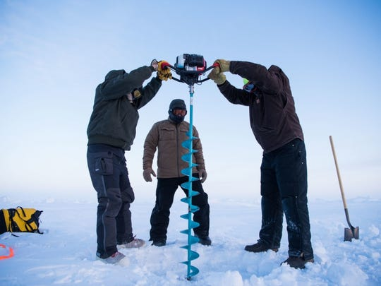 Members of Ice Camp Skate at the last Ice Exercise (ICEX) in 2018 drill a hole in the ice.